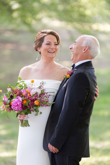 couple laughing in portrait for spring wedding in raleigh