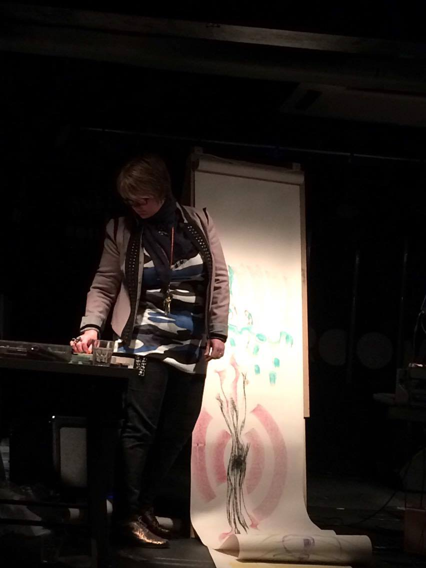 Poppy standing on stage about to get started drawing. Photo: Mandy Millyard