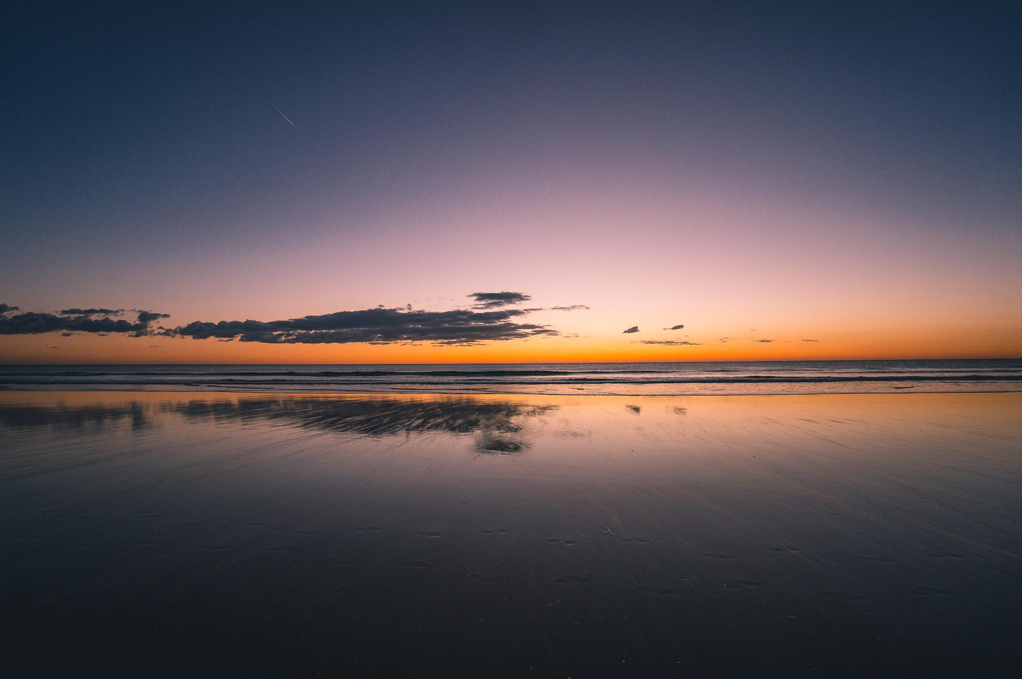 Odpływ towarzyszący zachodowi słońca w Conil