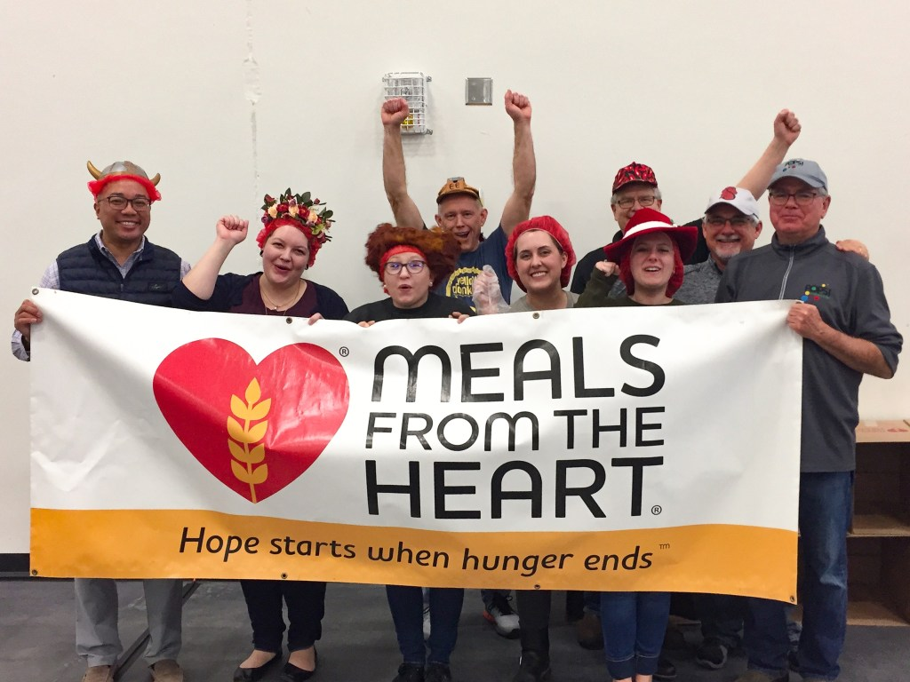 the POPS! Diabetes Care Team stands cheering with a Meals From The Heart sign