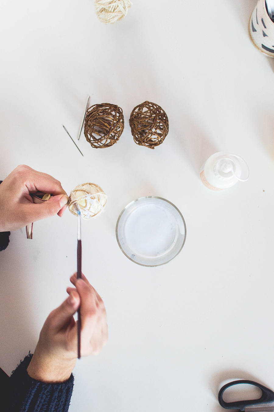 Make a twine sphere for your DIY winter scented garland