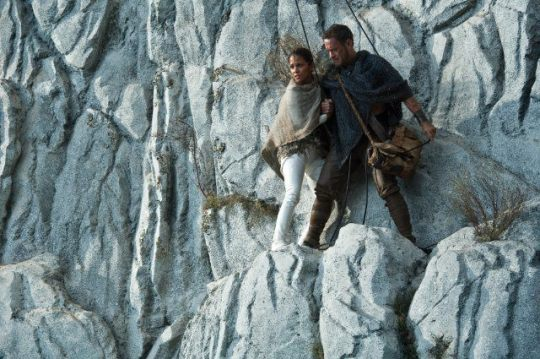 Meronym (Halle Berry) and Zachry (Tom Hanks) take turns at the pulley. Credit: Warner Bros. Pictures