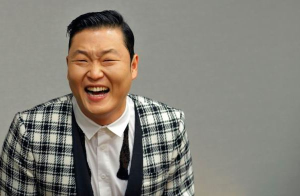File photo of South Korean singer Psy smiling as he attends a meeting with U.N. Secretary-General Ban during a photo opportunity at U.N. headquarters in New York