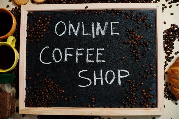 Online coffee shop. Words on blackboard flat lay.