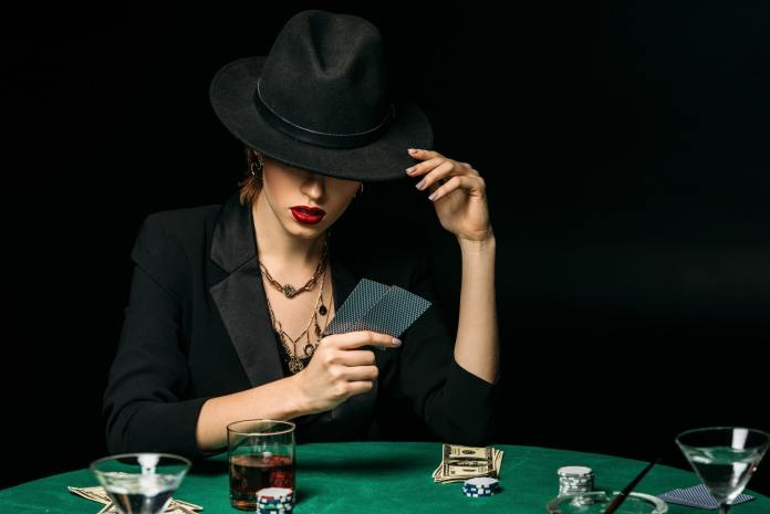 attra8 trends that will transform the future of the gambling industry ctive girl in jacket and hat playing poker in casino