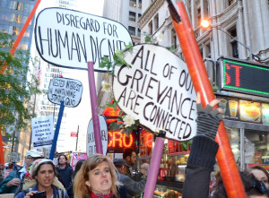 Occupy-Wall-St-All-Our-Grievances-are-Connected By Susan Rutman