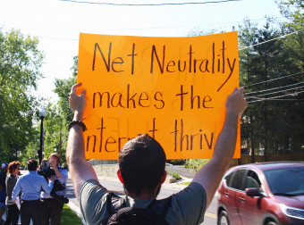 Lee Stewart protests outside Ajit Pai home on May 14, 2017. Photo by Eleanor Goldfield.