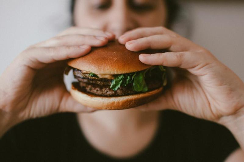 Person eating burger