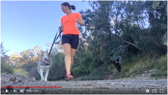 Video marketing a woman running with a dog