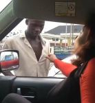 """""""Aboki I want to kiss you"""" – Lady holds aboki man on his shirt as she begs for kiss on the highway (Video)"""