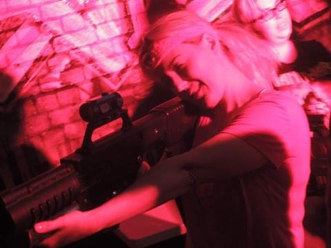 Dr Christ Dena checks the sight on her Tech Assault laser rifle