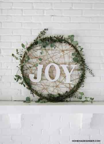 "How to Make a Christmas Wreath - 21 of the best Christmas Wreaths That You Can Make Yourself! This ""Joy"" wreath is simple adorable"