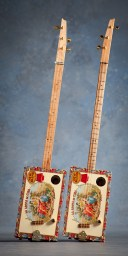 David Sutton's matching 3-string guitars, with and without frets
