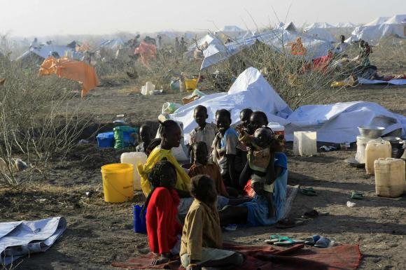 South Sudanese refugees wait inside a camp 10 km (6 miles) from al-Salam locality at the border of Sudan's White Nile state
