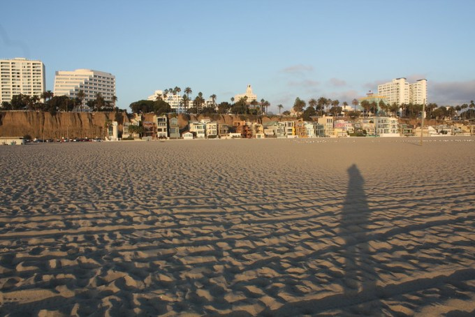 A look back at Santa Monica. My shadow is cast long over the sand thanks to sunset.