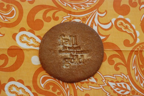 stamped cookie with the image that has been filled with pearl dust
