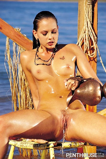 Cat Daniels posing nude for the February 1999 issue of Penthouse