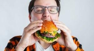 a fat man eat humburger