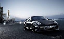 2011 black Porsche 911 GT2 RS wallpaper Front angle view