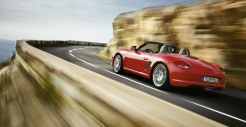 2011 Guards Red Porsche Boxster S wallpaper Side angle view