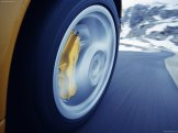 2006 Yellow Porsche 911 Carrera 4 Cabriolet Wallpaper Wheel in motion