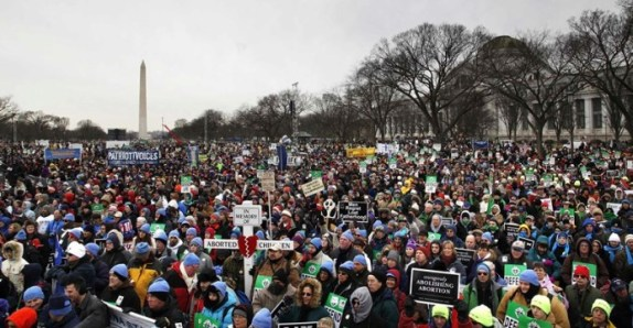 People participate in the annual March for Life rally on the National Mall in Washington Jan. 25. Thousands of anti-abortion demonstrators marched to the Supreme Court building marking the 40th anniversary of the Roe v. Wade ruling that legalizing abortion across the nation. (CNS photo/Jonathan Ernst, Reuters) (Jan. 25, 2013) See MARCH-SPEECHES, MARCH COLOR Jan. 25, 2013.