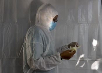 Doctor preparing to test patients suspected of being infected with corona virus in Rio De Janeiro, Brazil, on July 2020. (Photo by Fabio Teixeira/NurPhoto via Getty Images)