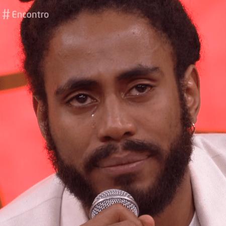 """Ícaro Silva ficou emocionado no """"Encontro"""" ao lembrar um ano da morte de Marielle   Reprodução/Globo   Reprodução/Globo"""