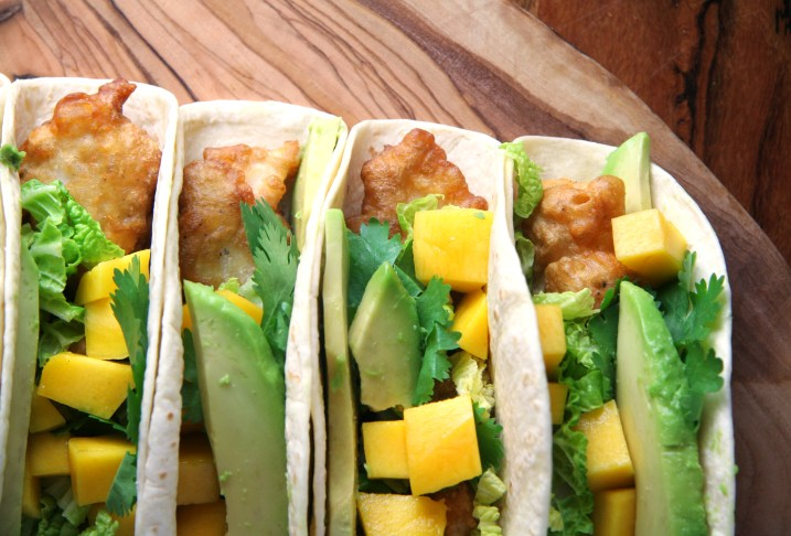 Beer Battered Fish Tacos with Mango, Avocado & Sriracha-Hoisin Drizzle