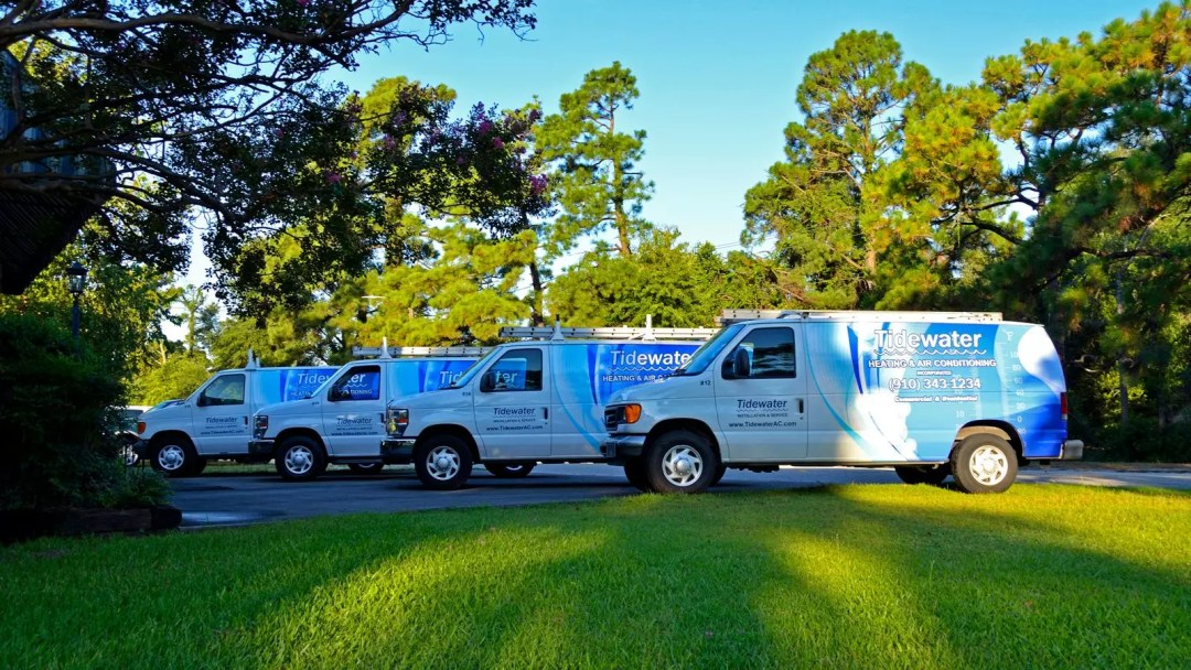 Tidewater Heating & Air van fleet with partial wraps (front)