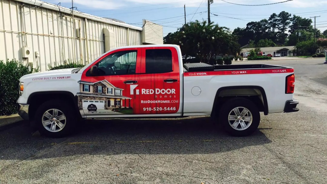 Red Door Homes partial truck wrap