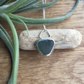 Green rounded triangle silver wrapped seaglass necklace.