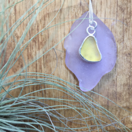 Bespoke ordered yellow seaglass necklace on purple seaglass.