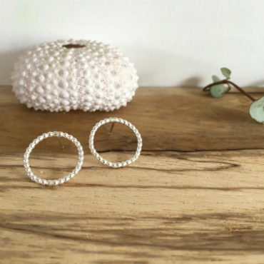 Circular studs made from beaded silver wire.