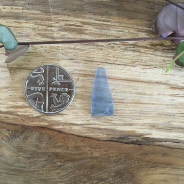 Long triangle of cornflower-blue seaglass from St Austell Bay.