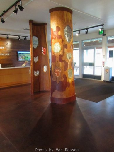 The entryway columns have a native american theme.