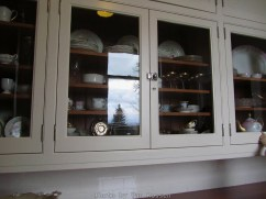 Glass front kitchen cabinet.