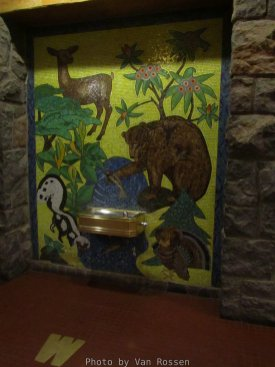 At tile mosaic around the drinking fountain.