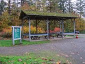 By the parking lot as you arrive it a covered picnic table area.