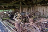 Out side building at the Cascade Locks Museum hold mostly old farm equipment.