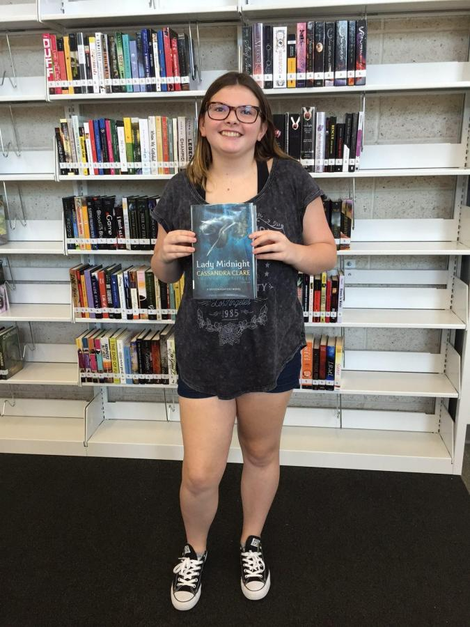 Freshman+Piper+Porter+checked+out+the+first+book+from+the+Learning+Commons.