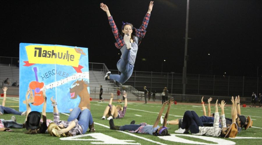 Freshman Ashley Presnell leaps in the air into a perfect split during Hercules' segment in the halftime show.