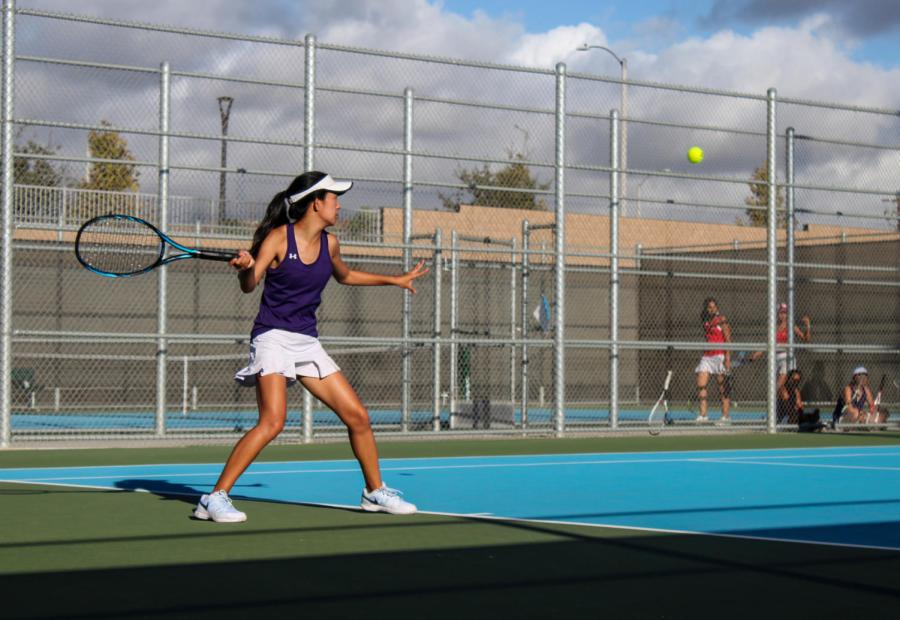 Sophomore Allison Shi returns a hit from her opponent.