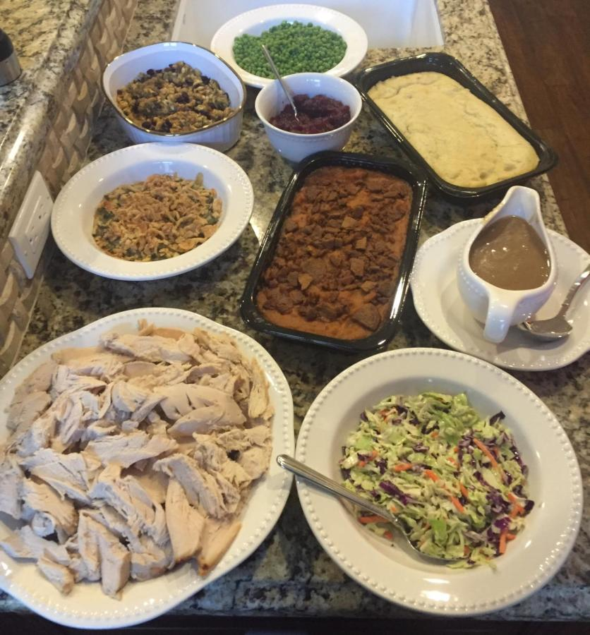 This is an example of a traditional American Thanksgiving dinner complete with turkey, mashed potatoes and gravy.
