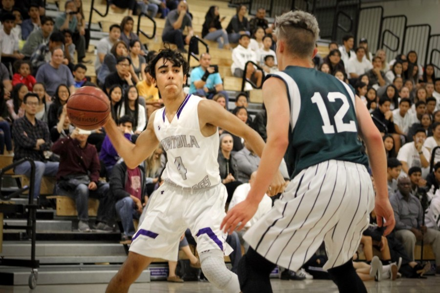 Sophomore and shooting guard #4 Omar Habibeh attempts to work around a defensive Pakuranga player in order to pass the ball to a teammate.