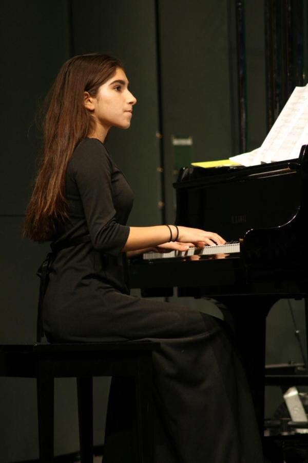 """Saba Najafi performs """"Mad Russian Christmas"""" on the piano during the second night of the winter concert."""