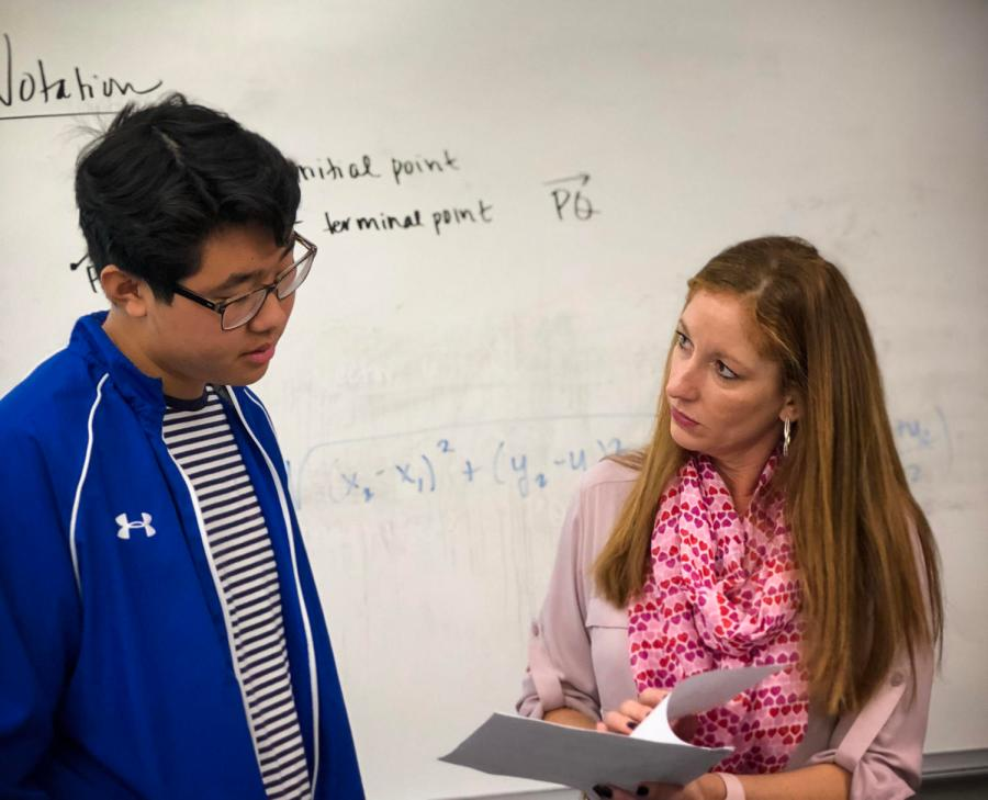 Continuing+her+teaching+in+Office+Hours%2C+Shelley+Godett+explains+the+answers+to+homework+questions+with+sophomore+Joshua+Kwon.+