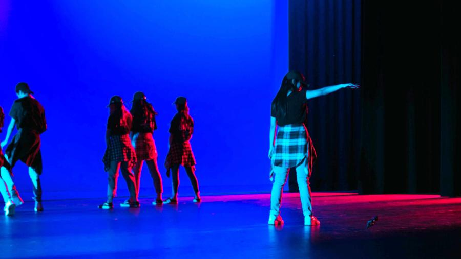 """A small group of dancers consisting of sophomores Miranda Wang, Julia Kim, Frances Ning and Paris Zhuang and freshmen Eric Hao and Kate Dang and complete their routine inspired by the official music video for the hit K-pop song """"Mic Drop"""" by BTS. As the theater fades to black, Dang ends the performance by dropping a microphone, imitating the iconic final move that gives the song its title."""