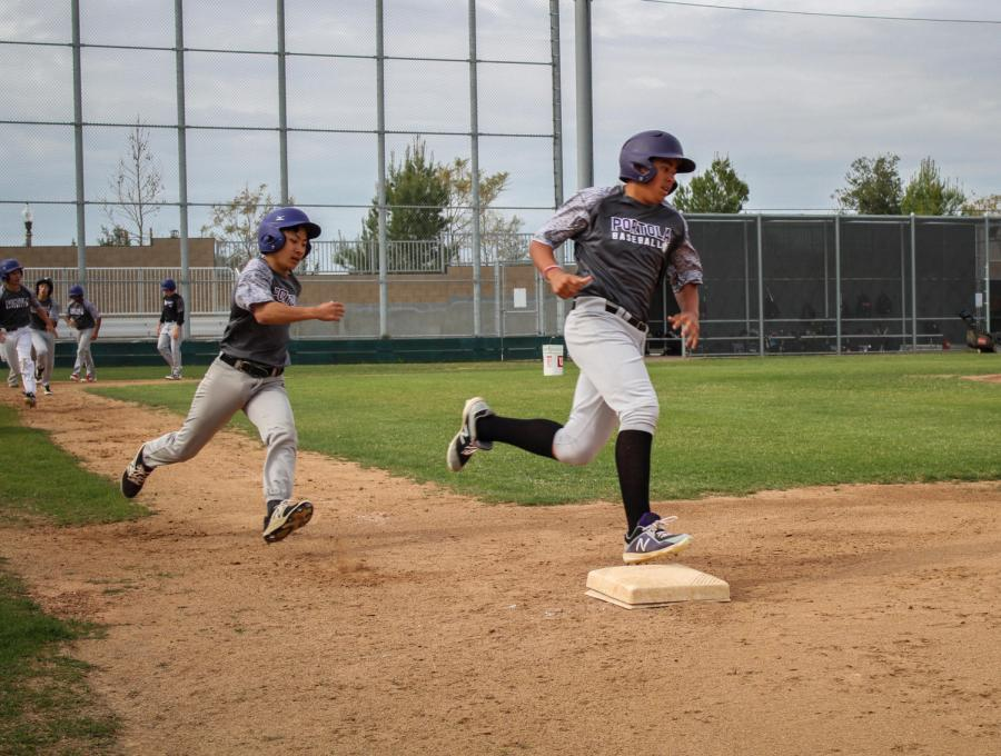 Freshmen Luke Shen and Anthony Mendez practice baserunning prior to a game.