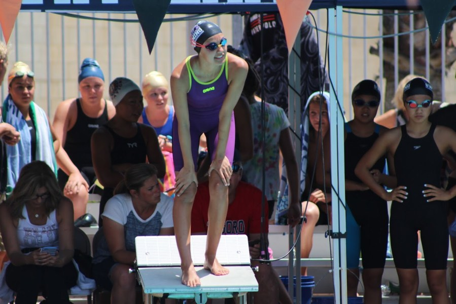 Sophomore+Gabi+Taylor+prepares+for+her+leg+of+the+200+medley+relay+by+waiting+on+the+diving+board.